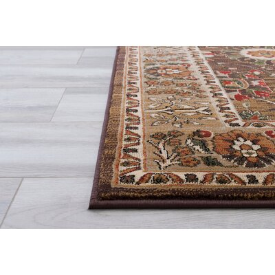 Woodson Floral Brown Area Rug