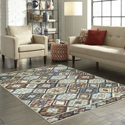 Chatelaine Tan Area Rug Rug Size: 5 x 7