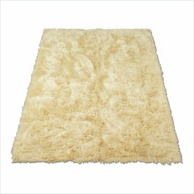Animal Ivory Area Rug Rug Size: 23 x 38