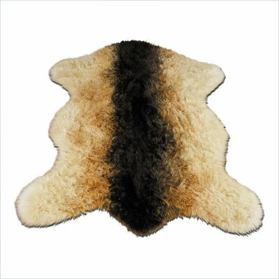 Animal Faux Sheepskin Beige/Black Area Rug Rug Size: 47 x 67