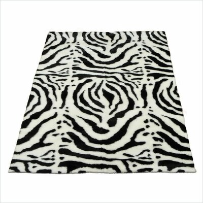 Animal Zebra White/Black Spine Area Rug Rug Size: 47 x 67
