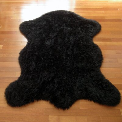 Animal Black Area Rug Rug Size: Rectangle 23 x 38