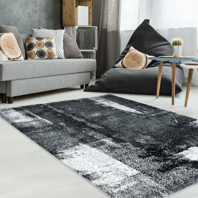 Ashleigh Unique Black/Gray Area Rug Rug Size: 710 x 105