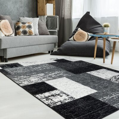 Collado Vintage Blocks Black Area Rug Rug Size: 65 x 95