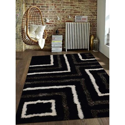 Patti Abstract Hand Tufted Black Area Rug Rug Size: 6 x 9