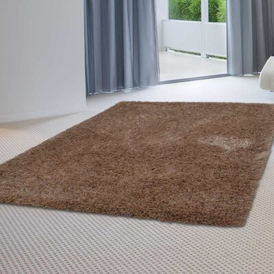 Sanford Solid Hand Tufted Beige Area Rug