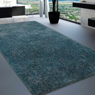 Sanford Solid Hand Tufted Firoza Area Rug