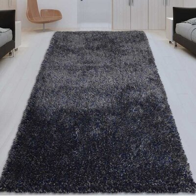 Sanford Solid Hand Tufted Blue Area Rug