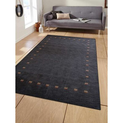 Ceniceros Solid Hand-Knotted Rectangle Wool Charcoal Area Rug