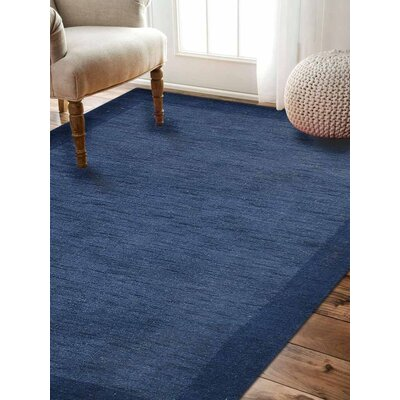 Ry Hand Knotted Loom Rectangle Wool Light Blue Area Rug Rug Size: 67 x 910