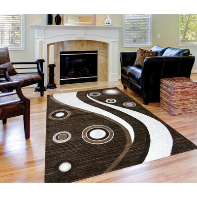 Spotted Brown Area Rug Rug Size: 8 x 11
