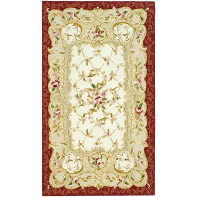 Brayton Ivory/Burgundy Area Rug Rug Size: Rectangle 39 x 59
