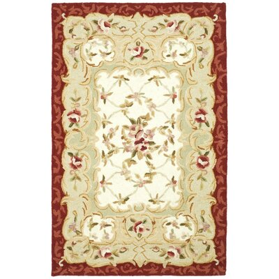Brayton Ivory/Burgundy Area Rug Rug Size: Rectangle 26 x 4