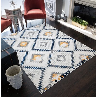 Leppert Tribal Beige Area Rug Rug Size: 53 x 7