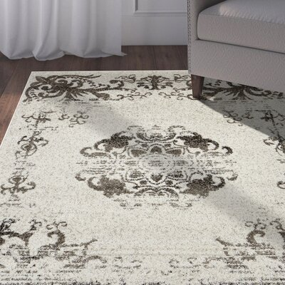 Pinson Beige/Walnut Area Rug Rug Size: Rectangle 79 x 95
