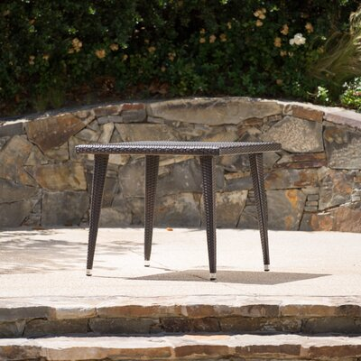 Malta Outdoor Wicker Dining Table Finish: Brown
