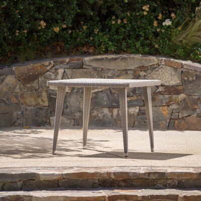Malta Outdoor Wicker Dining Table Finish: Chateau Gray