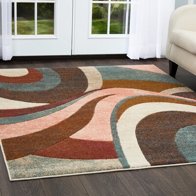 Dufresne Brown/Red Area Rug Rug Size: Rectangle 92 x 125