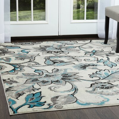 Kallie Ivory/Blue Area Rug Rug Size: Rectangle 5'2
