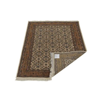 Marathon Hand-Knotted Wool Cream Area Rug Rug Size: 54 x 710