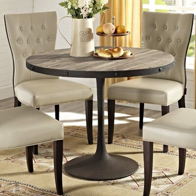 Omarion Industrial Dining Table Finish: Brown