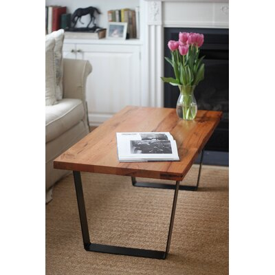 Crowder Coffee Table Size: 18.25 H x 48 W x 24 D, Table Base Color: Black