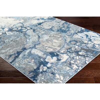 Candelaria Abstract Bright Blue/Navy Area Rug Rug Size: Rectangle 76 x 106