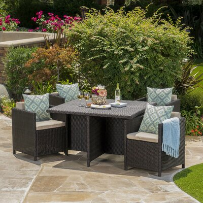 Cronius Outdoor Wicker 5 Piece Dining Set with Cushions Finish: Dark Brown
