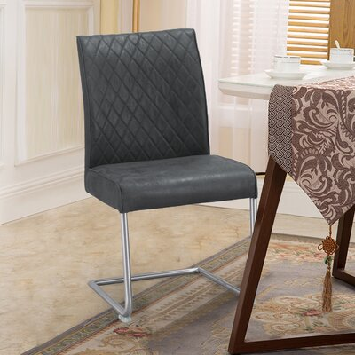Zolan Luxury Upholstered Dining Chair Color: Black