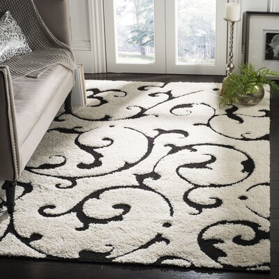 Tess Ivory/Black Area Rug Rug Size: Rectangle 53 x 76
