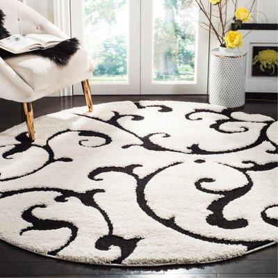 Tess Ivory/Black Area Rug Rug Size: Round 67