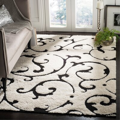Tess Ivory/Black Area Rug Rug Size: Rectangle 53 x 76