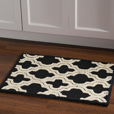 Savanah Hand-Tufted Black/Ivory Outdoor Area Rug Rug Size: Rectangle 110 x 210