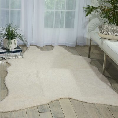 Bretta Ivory Novelty Area Rug