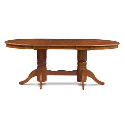 Inwood Oval-Shaped Extendable Dining Table Finish: Saddle Brown
