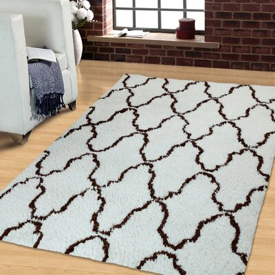 Superior Trellis Hand-Woven Ivory/Chocolate Area Rug Rug Size: Rectangle 5 x 8