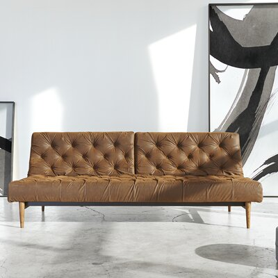 Chesterfield Convertible Sofa Upholstery: Velvet Dark Blue, Leg Finish: Brass