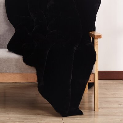 Leiser Hand-Woven Faux Fur Black Area Rug