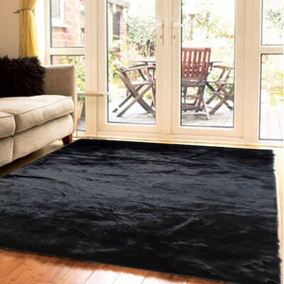 Mizzone Faux Fur Black Area Rug