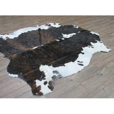 Tomlinson Hand-Woven Cowhide Black/Brown Area Rug