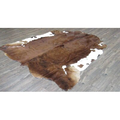 Williamstown Hand-Woven Cowhide Solid Brown/White Area Rug