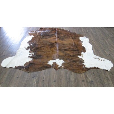 Lynnfield Modern Hand Woven Cowhide Solid Brown Area Rug