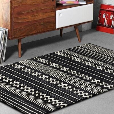 Byrnes Hand-Tufted Black/White Indoor Area Rug Rug Size: Rectangle 76 x 103