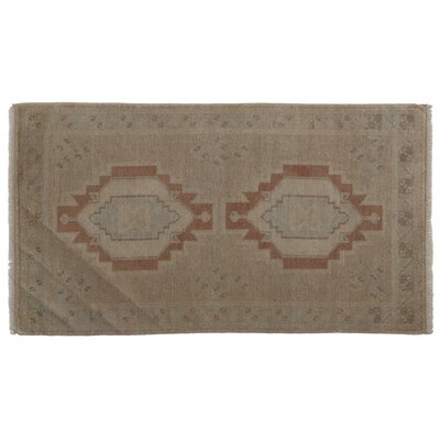 Mucklen Faded Hand-Knotted Wool Brown Area Rug