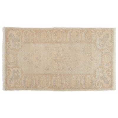 Nickolas Faded Hand-Knotted Wool Beige Area Rug