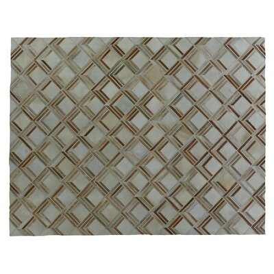 Natural Hide Beige/Brown Area Rug Rug Size: Rectangle 136 x 176