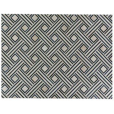 Natural Hide Beige/Black Area Rug Rug Size: Rectangle 136 x 176