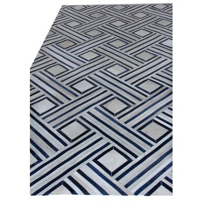 Natural Hide Beige/Black Area Rug Rug Size: Rectangle 116 x 146