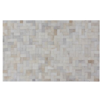 Natural Hide Hand-Tufted Cowhide Ivory Area Rug Rug Size: 5 x 8