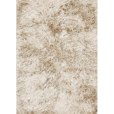 Treasure Solid Vanilla Area Rug Rug Size: 66 x 98